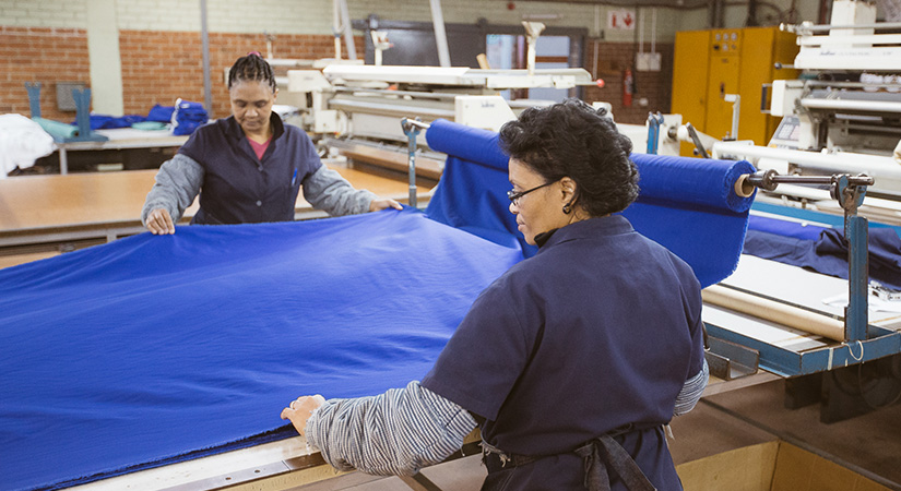 Women working with essential workwear protective safety material